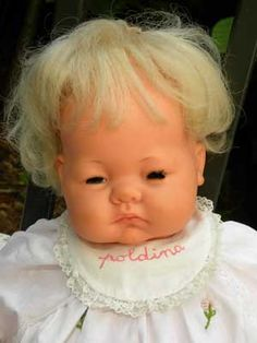 I had twin babies identical to this one... A boy and girl my mother bought me after my sister was born... I was 7 1/2 - Poldina Furga.. My first doll