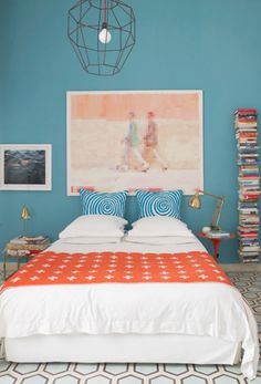 A 1930s bungalow in Marrakech. Coral, blue + white decor.
