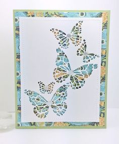 hand crafted card ... Reverse bfly collage .. die cut negative space butterflies over patterned paper ... delightful!