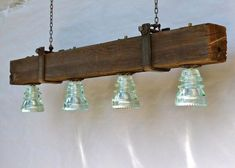 The upcycled LED chandelier perfect for a rustic, industrial and modern interior. Our Insulator Lights are regionally sourced and made in the USA. Insulator Lights, Glass Insulators, Glass Bottles, Cool Chandeliers, Glass Chandelier, Interior Led Lights, Interior Sliding Barn Doors, Artwork For Home, Rustic Lighting