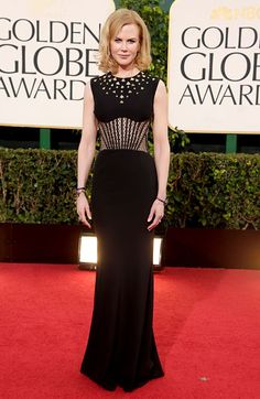 Nicole Kidman wore an Alexander McQueen gown, Manolo Blahnik shoes and Fred Leighton jewelry to the 2013 Golden Globes.