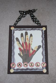 $15.  Cute family picture using everyone's handprints.