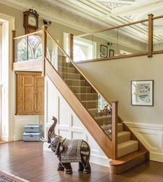 Dark Oak In-Line Glass Staircase - Neville Johnson This beautiful dark oak in-line glass staircase has transformed this house. The in-line glass increases the light in the hallway and compliments the room. Oak Stairs, Glass Stairs, House Stairs, Stairs With Glass Balustrade, Staircase In Living Room, Glass Stair Railing, Glass Bannister, Glass Handrail, Staircase Railings