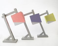 Super stylish desk lamps that bring color and brightness even when they're turned off! I want one!!!!!
