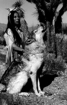 Can't find citation, but what an incredible picture. Native American woman and, what appears to be, a hybrid wolf.