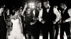 Wedding party gets down on the dance floor at the reception | Palace Resorts Weddings ®