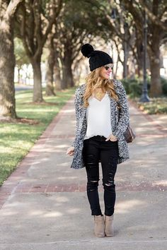 Wearing a super casual, laid back look featuring a slouchy beanie outfit styled with a long cardigan, black distressed jeans and ankle booties for winter.