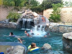 Pool Designs With Rock Slides built in swimming pool slides custom waterfall and slide all rock was hand laid Slide For Pool Remodel Backyard Pinterest Pool Remodel And Pool Slides