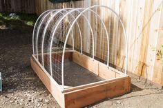 DIY Covered Greenhouse Garden: A Removable Cover Solution to Protect Your Plants — Apartment Therapy Tutorials Small Greenhouse, Greenhouse Plans, Greenhouse Gardening, Greenhouse Wedding, Greenhouse Gases, Outdoor Projects, Garden Projects, Organic Gardening, Gardening Tips