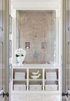 Bathroom Storage wall! Interesting idea for lower level bath!