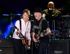 INDIO, CA - OCTOBER 08: Musician Neil Young (R) performs with Sir Paul McCartney onstage during Desert Trip at The Empire Polo Club on October 8, 2016 in Indio, California. (Photo by Kevin Mazur/Getty Images for Desert Trip)