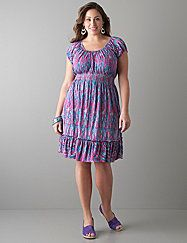Flattering short sleeve peasant dress features a colorful abstract print that's just right for so many occasions. Accentuate your curves with the scoop neckline, smocked waist and ruffled skirt. Soft-to-the-touch knit offers a beautiful drape and lightweight feel that's ideal year round. lanebryant.com