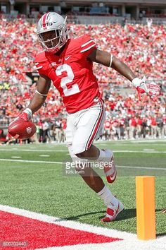 News Photo : Dontre Wilson of the Ohio State Buckeyes scores a...