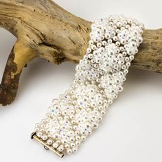 Craters never looked so luscious! Using several different sizes of Swarovski Elements (Pearls and Crystals), you will be working a pattern with right angle weave, then you'll add surface embellishment