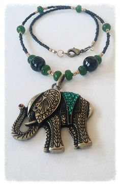 USE COUPON CODE HOLIDAY15 FOR 20% OFF on Lucky Jade Tibetan Elephant Pendant by GemsbyJoniH on Etsy