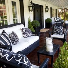 Black and white porch lends itself to a sophisticated space. The beautiful wood floors makes it warm and homey.