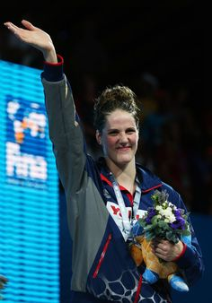 Gold medal winner Missy Franklin of the USA celebrates on the podium after the Swimming Women's 200m Freestyle Final