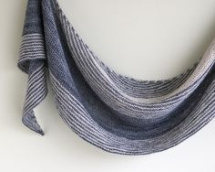 Two rebellious stripes gone rogue make this crescent shaped, striped shawl stand out from the crowd. Dissent by Lisa Mutch is two-color shawl that uses short-row shaping to create balanced yet asymmetrical stripes.
