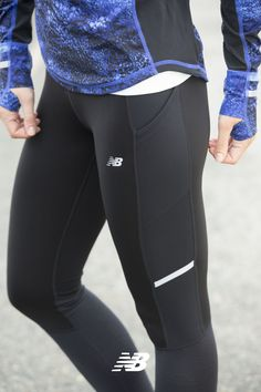 Our women's NB Heat Tight has technology to help keep you warm  and reflective trim to add shimmer to your stride. Added bonus- there is a hip pocket that's perfect for stashing essentials like keys and cash.