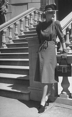 """""""Model is wearing a dress with embossed quilting and high roll shoulders, 1938. Photographed for LIFE Magazine. #vintage #fashion #1930s #hat"""