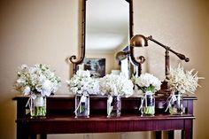 White flowers in jars.