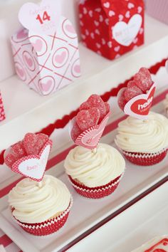 Valentine cupcake with new twist on cupcake toppers- heart pocket filed with candy