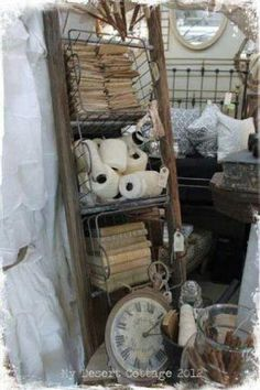 Great way to use an old ladder!! - lay baskets on their side, in between the rungs by francis