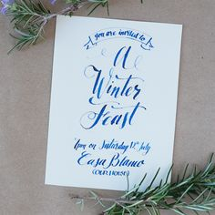 A Winter Feast invitation design.