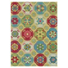 Hand-hooked rug with a floral medallion motif.   Product: RugConstruction Material: 100% PolyesterCol...