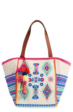 So fun and festive! This carryall is perfect for toting around all the essentials this season.