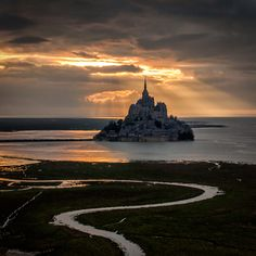 Gorgeous! The heaven light over the Mont Saint-Michel | France (by Mathieu Rivrin)