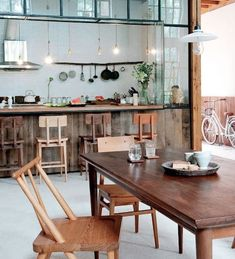 Open living and dining room with all wood furniture in Beijing, Remodelista