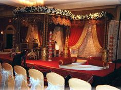 elaborate indian wedding canopy with flowers, jewels and beading. exquisite.