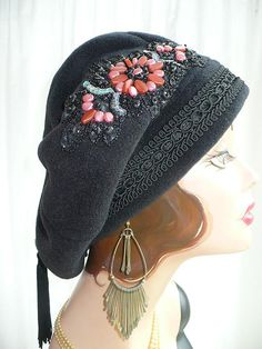 Floppy slouchy fleece beret with swinging rayon tassel and beaded applique. By Great Hat!