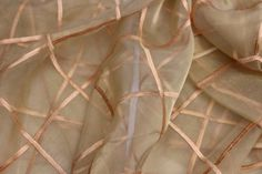 Description Gold sheer embroidered with a gold window pane pattern. Size Round Complimentary Colors Use with Gold Satin, turquoise Bengaline.