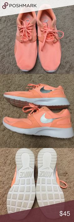 Nike shoes Worn twice. Excellent condition. These are a size 11 but can fit a size 10 to 10 1/2. I wear a 10 and they fit me fine.  The color is a very pretty orange coral. Nike Shoes Athletic Shoes