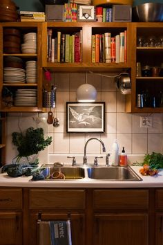20 Organized Kitchens from Real Cooks--I like the effect of the lights in this picture.  I miss incandescent lights!