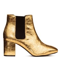 Gold-colored. Ankle boots with elasticated panels at sides and covered heels. Imitation leather lining and insoles and rubber soles. Heel height 3 in.