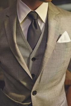 This is a tasteful suit that seems to fit appropriately. Garish pocket squares are a big no-no but this neat white one is completely appropriate.