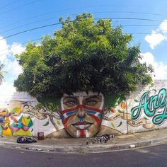 Street art and nature don't usually intersect, especially in large cities where most graffiti and tagging can be found. These gorgeous images are the exception — a beautiful melding of street art and urban flora. 3d Street Art, Amazing Street Art, Street Art Graffiti, Street Artists, Amazing Art, Awesome, Street Mural, Graffiti Kunst, Banksy Graffiti