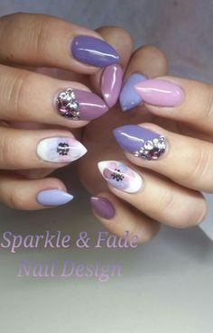 Elegant purple nails with Swarovski crystals and a handpainted accent nail - Done by Christine Ingalls of Sparkle and Fade Nail Design https://www.facebook.com/SparkleAndFadeNailDesign