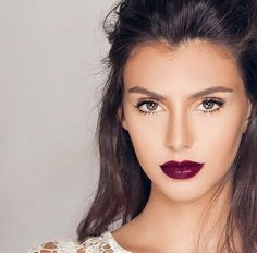 "Let the lips do all the talking by keeping your eyes neutral. Check out NYX Cosmetics Extra Creamy Round Lipstick in ""Black Cherry,"" to find your perfect berry hue."