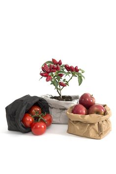 Uashmama paper bags look like leather, but are eco-friendly and handmade. Use in your home for kitchen or bathroom storage, or as a decorative plant holder.