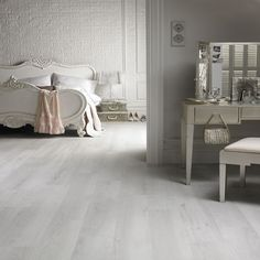 White washed laminate flooring. It gives the space such a light and serene feel.