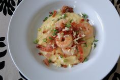 Shrimp and Cheese Grits.....Some of the best shrimp & grits. I use the yellow course ground grits. Have even made it with smoked Gouda instead of sharp cheddar and is delicious too!