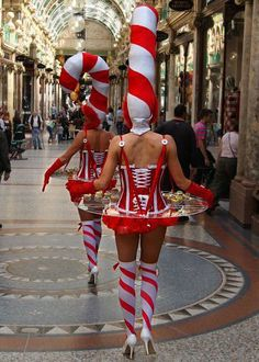 Hire Walk Around Act | Candy Cane Hostesses | Themed Strolling Tables  These glamorous Hostesses are the perfect walk about act to serve all sorts of delicious treats at your event!