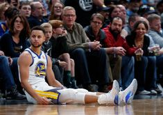 Golden State Warriors guard Stephen Curry sits on the floor after hitting a 3-point basket against the Denver Nuggets during the second half of an NBA basketball game Saturday, Feb. 3, 2018, in Denver. The Nuggets won 115-108. (AP Photo/David Zalubowski)