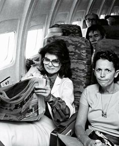 She looks like she is in a awkward position , I mean a woman like her in a public plane , I'm sure it was aggravating when a bunch of random people was freaking out because it was old First Lady Jacqueline kennedy , America's favorite woman!!
