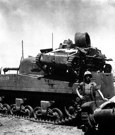 An American M4A2 carrying a Japanese Type 94 light-tank on its back, Namur, 1944. Mil-Mall.com