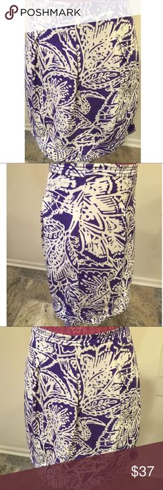 Ann Taylor Purple Floral Pleated Skirt Size 4 Ann Taylor Size ~ 4 Shell ~ 100% cotton Lining ~ 100% polyester  Waist ~ 16 Hips ~ 21.5 Length ~ 21 Hidden side zipper Hook & eye Multicolored Ann Taylor Skirts A-Line or Full